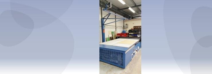 Banner photo of a cutting unit in a factory with a light blue background