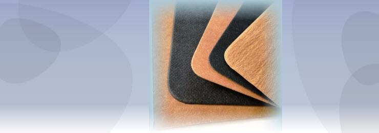 photo of resin rubber soling material samples in black and brown fanned out
