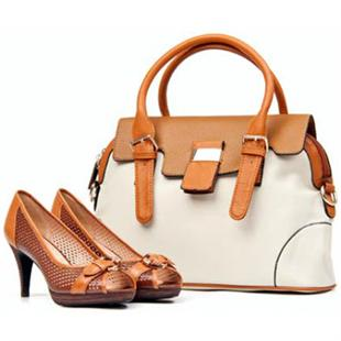 view of high quality high heel shoes and a handbag